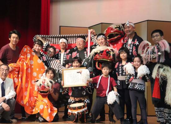 東京讃岐獅子舞と誕生獅子保存会の集合写真